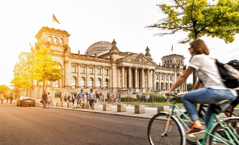 Urban city life with famous Reichstag building in the background, Berlin (Photo: canadastock/Shutterstock)