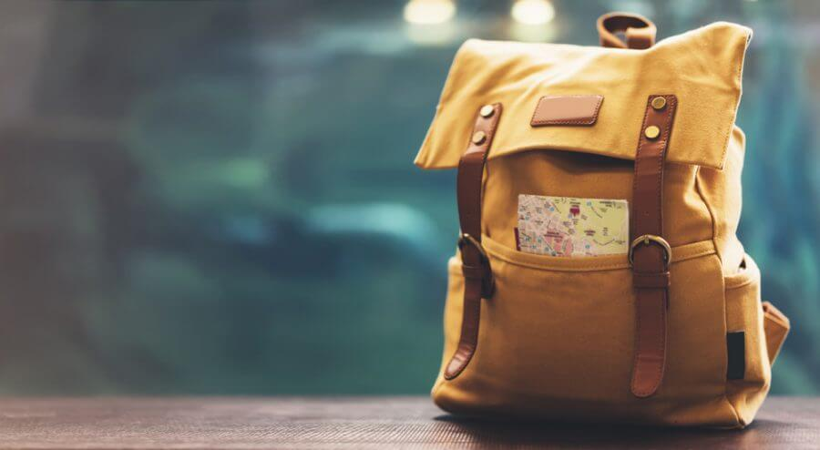 A backpack with a map for job relocation